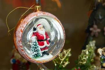Toys Santa Claus and  Christmas-tree in Christmas decoration ball. Merry Christmas and Happy New Year background.