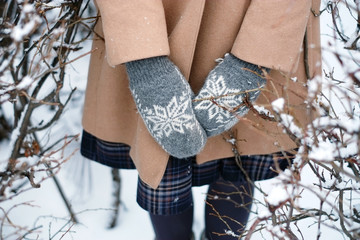 Close up shot of the woman's hands in mittens