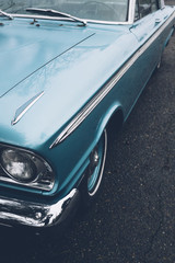 Detail of vintage car, focus on headlight