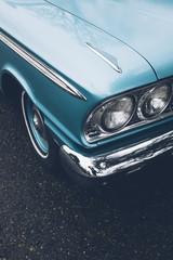 Detail of vintage car, focus on headlight
