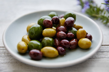 Still life of fresh olives on plate