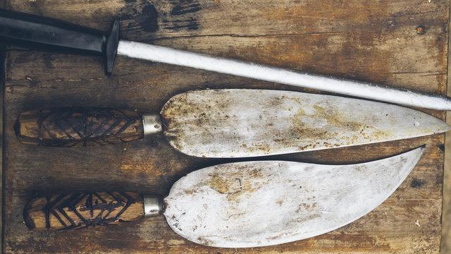 Antique knife on wooden