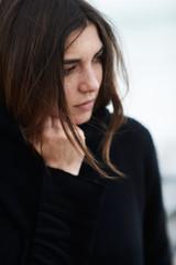Portrait of woman on twenties wearing a turtleneck sweater