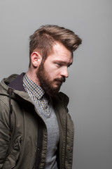 Stylish thoughtful man with a trendy hairstyle