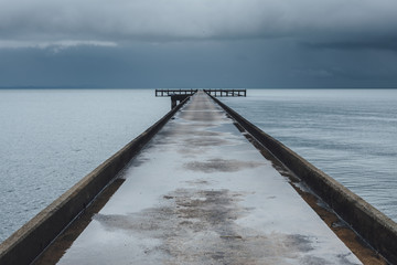 Concrete dock on the stormy sea