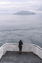 Traveller taking a picture during the navigation on a ferry