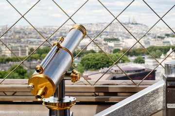 Vintage telescope looking at Paris from the Eiffel Tower