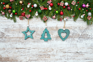 Christmas background. Christmas fir tree with blue Christmas decoration on wooden background. Copy space