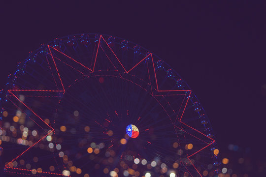 bokeh lights in the background of ferris wheel at night , filtered tones