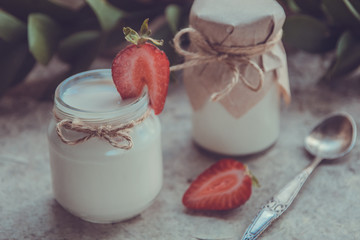 Organic yougurt in jar with strawberry. Fresh strawberry with yogurt