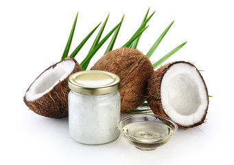 Coconut and glass jar with fresh coconut oil isolated on white background.