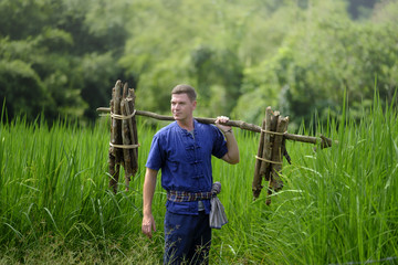 Foreign tourists in Thailand, traditional Thai dress farmer back to nature life concept
