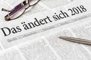Zeitung mit der Überschrift Das ändert sich 2018