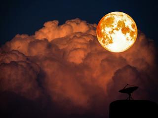 super full blood moon and sattlelite disk on dark orange heap cloud