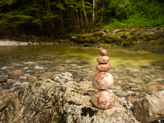 A pile of stones beside a river in the Austrian alps