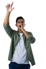 Man shouting and gesturing against white background