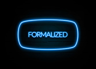 Formalized  - colorful Neon Sign on brickwall