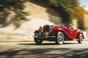 Red vintage car at sunset