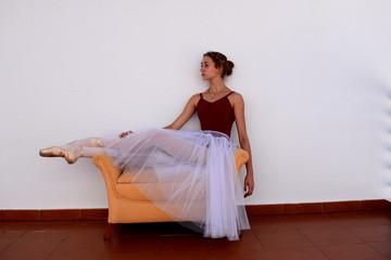 Ballet dancer is resting after training..
