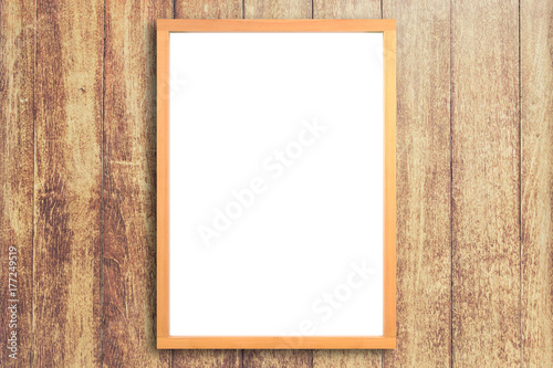 White poster with wood frame mockup on wooden wall background. mock ...