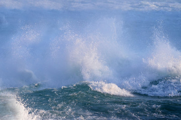 Boiling powerful water streams fall with splashes creating waves, background