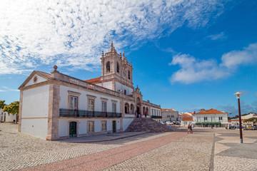 The view of Nossa Senhora da Nazare Church on the central square of small town Nazare. Portugal
