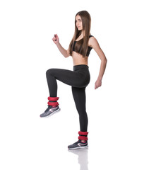 Athletic young woman doing aerobics exercise in fitness gym isolated over white background.