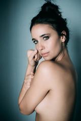 Sensual topless woman on wall