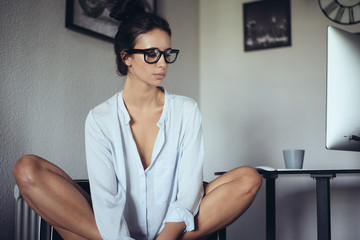 woman sitting looking to the side