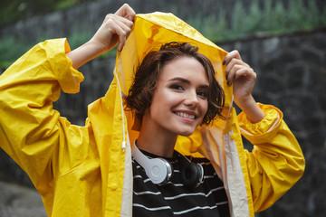 Portrait of a smiling joyful teenage girl with headphones