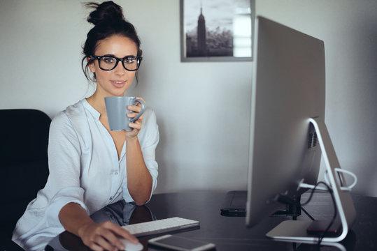 Pretty woman using computer