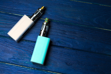 two e-cigarette (electronic cigarette, vape) on the wood background