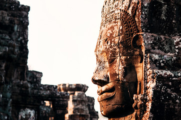 Huge carved Buddha stone face of Bayon Temple, Angkor, Siem Reap, Cambodia. Ancient Khmer architecture