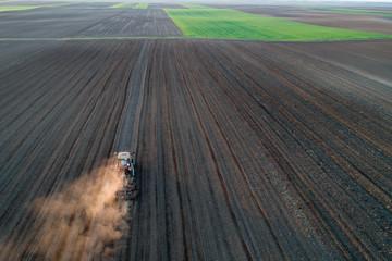 Tractor harrowing soil