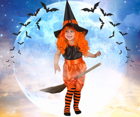 Little girl witch flying on a broom across the sky.