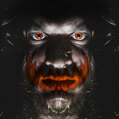 Portrait of a man with a red eye for horror or halloween. Joker orange smile