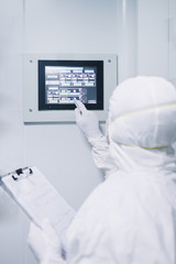 Scientist operating with display