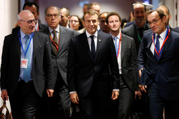 Macron arrives to attend a bilateral meeting during a EU leaders summit meeting in Brussels