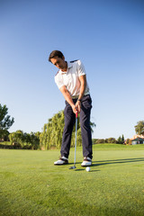 Man playing golf at a golf course