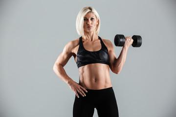 Portrait of a motivated muscular sportswoman