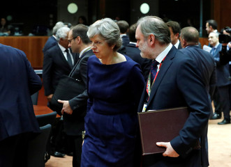 May and Britain's permanent representative to the EU Barrow arrive at EU summit in Brussels