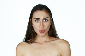Shoked woman stands on white background
