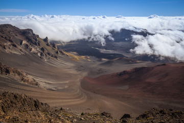 The Haleakala crater at the top of the volcano is seen by the visitor center at 9,740 feet on a typical day fog