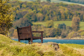 Empty bench on the coast of lake or sea