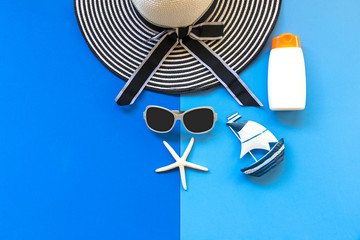 Summer Fashion woman big hat and sunglasses go to travel in the beach. Tropical sea.Unusual top view,  background.  Summer Concept.