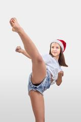 In the Santa Claus hat, the girl beats kick leg