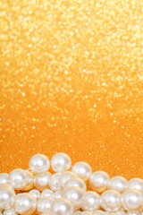 Pile of pearls on golden christmas background