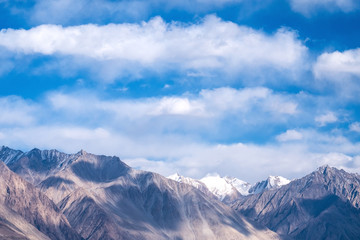 Closeup image of mountains and blue sky with clouds background in Ladakh , India