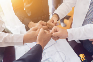 Asian businessman with Hands together,Team Business Partners Giving Fist Bump to Greeting Start up project with Contractor. Corporate Teamwork Partnership in an Office Meeting,Business Concept,vintage