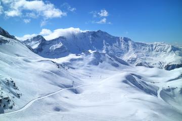 Winter mountain panorama with fresh snow on skiing tracks, Meribel slopes, 3 Valleys resort, Alps, France